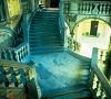 la suggestiva scalone a 4 rampe di Palazzo Somaglia a Piacenza